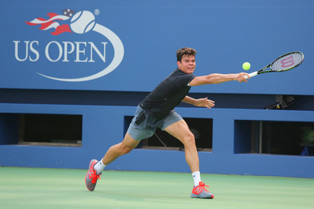 grand hard: NEW YORK - AUGUST 25, 2015: Professional tennis player Milos Raonic of Canada practices for US Open 2015 at Billie Jean King National Tennis Center in New York