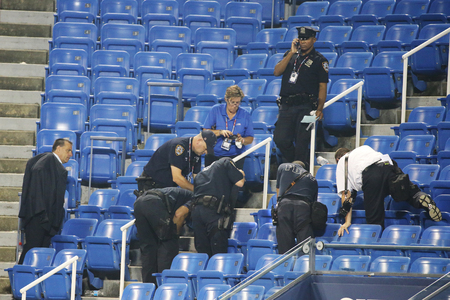 NEW YORK - SEPTEMBER 3, 2015: New York Police Department investigates incident involving drone during match at US Open 2015 at Billie Jean King National Tennis Center in New York