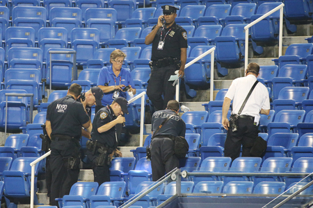 investigates: NEW YORK - SEPTEMBER 3, 2015: New York Police Department investigates incident involving drone during match at US Open 2015 at Billie Jean King National Tennis Center in New York