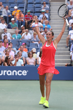 racket stadium: NEW YORK - SEPTEMBER 7, 2015: Professional tennis player Roberta Vinci of Italy celebrates victory after her quarterfinal match at US Open 2015 at National Tennis Center in New York