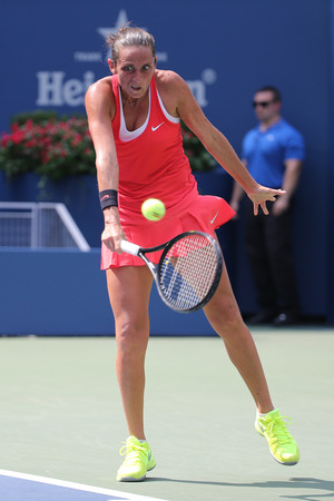 racket stadium: NEW YORK - SEPTEMBER 7, 2015: Professional tennis player Roberta Vinci of Italy in action during her quarterfinal match at US Open 2015 at National Tennis Center in New York Editorial
