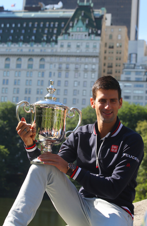 atp: NEW YORK - SEPTEMBER 14, 2015: Ten times Grand Slam champion Novak Djokovic posing in Central Park with championship trophy after victory at US Open 2015 Editorial
