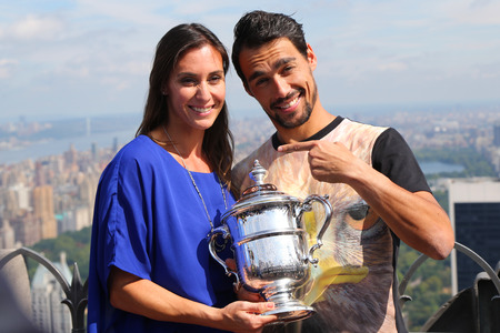 us open: NEW YORK CITY - SEPTEMBER 13, 2015: US Open 2015 champion Flavia Pennetta and tennis player Fabio Fognini posing with US Open trophy on the Top of the Rock Observation Deck at Rockefeller Center
