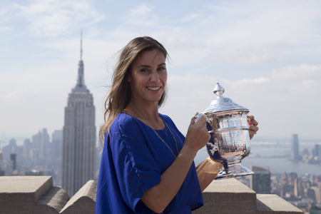 us open: NEW YORK CITY - SEPTEMBER 13, 2015: US Open 2015 champion Flavia Pennetta posing with US Open trophy on the Top of the Rock Observation Deck at Rockefeller Center in New York Editorial