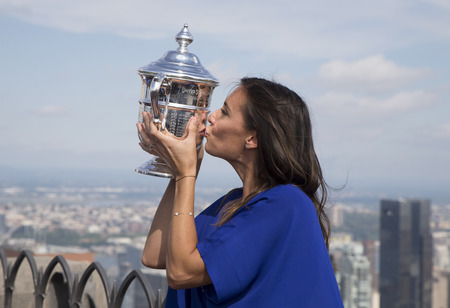 grand slam: NEW YORK CITY - SEPTEMBER 13, 2015: US Open 2015 champion Flavia Pennetta posing with US Open trophy on the Top of the Rock Observation Deck at Rockefeller Center in New York Editorial