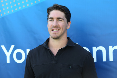 hosts: NEW YORK - SEPTEMBER 7, 2015: New York Rangers captain Ryan McDonald hosts youth tennis exhibition at US Open 2015 at National Tennis Center in New York