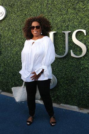 philanthropist: NEW YORK - SEPTEMBER 8, 2015: Oprah Winfrey attends US Open 2015 tennis match between Serena and Venus Williams at USTA Billie Jean King National Tennis Center in New York