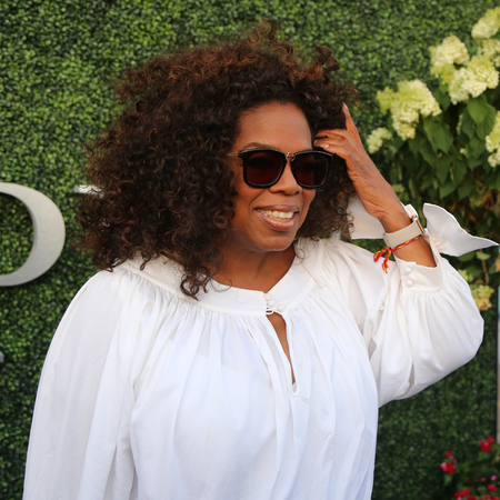 philanthropist: NEW YORK - SEPTEMBER 8, 2015: Oprah Winfrey attends US Open 2015 tennis match between Serena and Venus Williams at USTA Billie Jean King National Tennis Center in New York