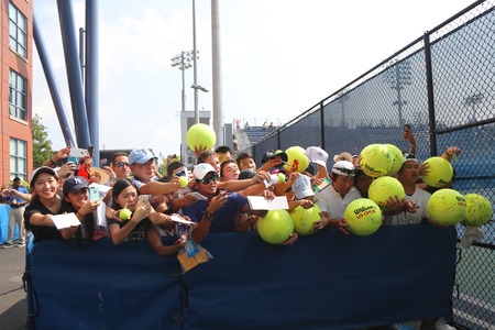 grand slam: NEW YORK - SEPTEMBER 1, 2015: Tennis fans waiting for autographs at Billie Jean King National Tennis Center in New York. US Open is a final Grand Slam tournament of the year