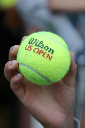 atp: NEW YORK - SEPTEMBER 3, 2015: US Open Wilson tennis ball at Billie Jean King National Tennis Center in New York. Wilson is the Official Ball of the US Open since 1979
