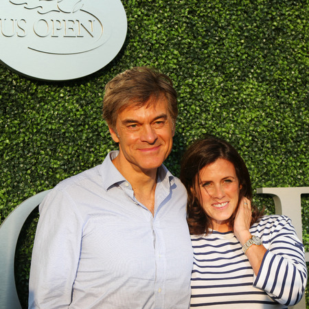 dr: NEW YORK - SEPTEMBER 8, 2015:Dr Mehmet Oz aka Dr Oz and his wife Lisa Oz attend US Open 2015 tennis match between Serena and Venus Williams at USTA Billie Jean King National Tennis Center in New York Editorial