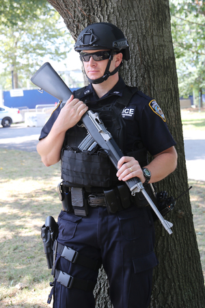counter terrorism: NEW YORK - SEPTEMBER 13, 2015: NYPD counter terrorism officer providing security at National Tennis Center during US Open 2015 in New York Editorial