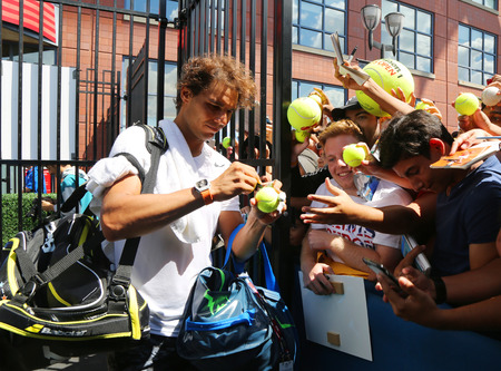 billie: NEW YORK - AUGUST 27, 2015: Fourteen times Grand Slam champion Rafael Nadal of Spain signing autographs after practice for US Open 2015 at Billie Jean King National Tennis Center in New York Editorial