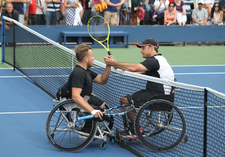 atp: NEW YORK - SEPTEMBER 13, 2015: US Open 2015 champion Dylan Alcott of Australia L with David Wagner R after Wheelchair Quad Singles final match at Billie Jean King National Tennis Center in NY