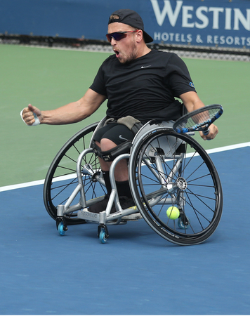 atp: NEW YORK - SEPTEMBER 13, 2015: Tennis player Dylan Alcott of Australia celebrates victory after Wheelchair Quad Singles final match at US OPEN 2015 at Billie Jean King National Tennis Center in NY