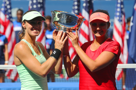 doubles: NEW YORK - SEPTEMBER 13, 2015: Five times Grand Slam champion Martina Hingis L and Sania Mirza R during women s doubles trophy presentation  at US Open 2015 Editorial