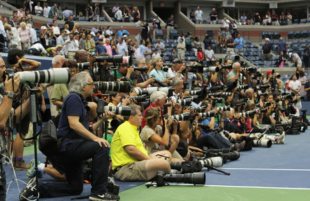 center court: NEW YORK- SEPTEMBER 12, 2015: Professional photographers on tennis court during trophy presentation at the Arthur Ashe Stadium at Billie Jean King National Tennis Center in New York