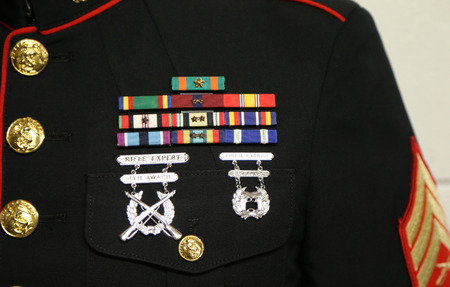 NEW YORK - SEPTEMBER 13, 2015: American Military ribbons and badges on United States Marine Dress Blue Uniform in New York