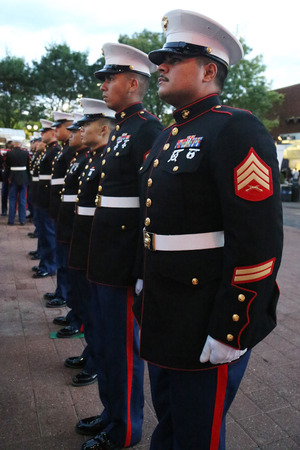 billie: NEW YORK- SEPTEMBER 13, 2015:  United States Marine Corps officers at Billie Jean King National Tennis Center before unfurling the American flag prior US Open 2015 men s final in New York Editorial