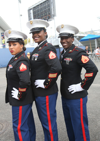 unfurling: NEW YORK- SEPTEMBER 13, 2015:  United States Marine Corps officers at Billie Jean King National Tennis Center before unfurling the American flag prior US Open 2015 men s final in New York Editorial