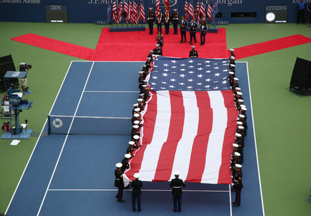 unfurling: NEW YORK- SEPTEMBER 12, 2015: US Marine Corps unfurling American Flag during the opening ceremony of the US Open 2015 women s final at Billie Jean King National Tennis Center in New York Editorial