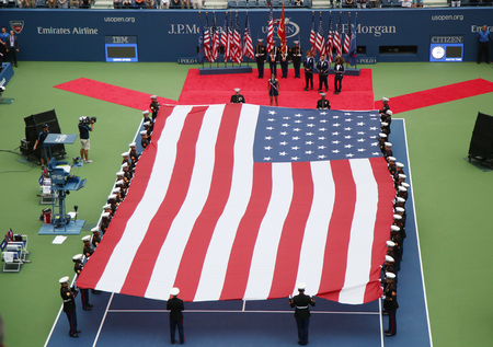 billie: NEW YORK- SEPTEMBER 12, 2015: US Marine Corps unfurling American Flag during the opening ceremony of the US Open 2015 women s final at Billie Jean King National Tennis Center in New York Editorial