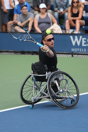 atp: NEW YORK - SEPTEMBER 13, 2015: Tennis player Dylan Alcott of Australia in action during his Wheelchair Quad Singles final match at US OPEN 2015 at Billie Jean King National Tennis Center in NY