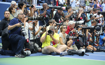 arthur: NEW YORK- SEPTEMBER 12, 2015: Professional photographers on tennis court during trophy presentation at the Arthur Ashe Stadium at Billie Jean King National Tennis Center in New York