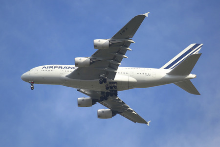 world's: NEW YORK - SEPTEMBER 27, 2015: Air France Airbus A380 in New York sky before landing at JFK Airport. The Airbus A380 is a double-deck, wide-body, world s largest passenger airliner Editorial