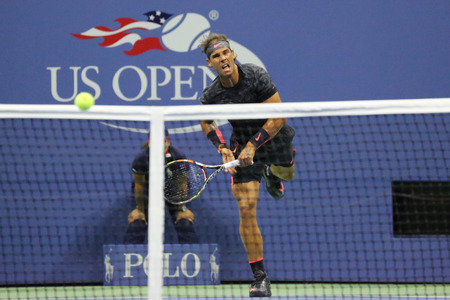 champion spain: NEW YORK - AUGUST 31, 2015: Fourteen times Grand Slam Champion Rafael Nadal of Spain in action during his opening match at US Open 2015 at Billie Jean King National Tennis Center in New York