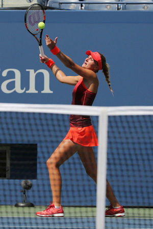 racket stadium: NEW YORK - SEPTEMBER 8, 2015: Professional tennis player Kristina Mladenovic of France in action during her US Open 2015 match at Billie Jean King National Tennis Center in New York Editorial