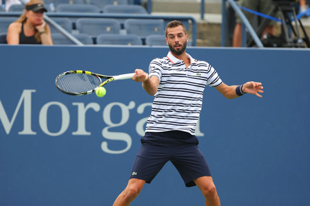 grand hard: NEW YORK - AUGUST 31, 2015: Professional tennis player Benoit Paire of France in action during first round match at US Open 2015 at Billie Jean King National Tennis Center in New York Editorial