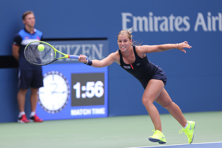 backhand: NEW YORK - AUGUST 31, 2015: Professional tennis player Dominika Cibulkova of Slovakia in action during first round match at US Open 2015 at Billie Jean King National Tennis Center in New York