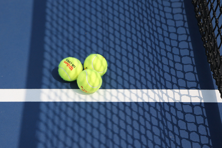 us open: NEW YORK - SEPTEMBER 1, 2015: US Open Wilson tennis ball at Billie Jean King National Tennis Center in New York. Wilson is the Official Ball of the US Open since 1979