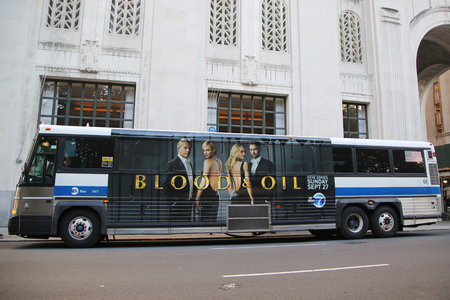 NEW YORK - SEPTEMBER 6, 2015: New York City MTA bus with Blood and Oil series advertisement at Madison Park Square in Manhattan Imagens - 45924530