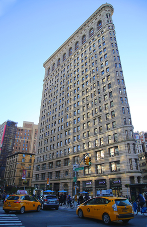 flatiron: NEW YORK - OCTOBER 6, 2015: Historic Flatiron Building in Manhattan.This iconic triangular building located in Manhattan s Fifth Ave was completed in 1902