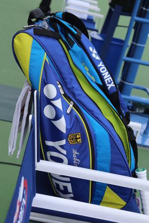 us open: NEW YORK - SEPTEMBER 3, 2015: Professional tennis players Sabine Lisicki customized Yonex tennis bag at US Open 2015 at Billie Jean King National Tennis Center in New York Editorial