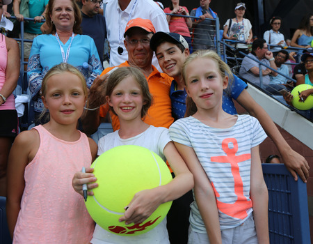 grand slam: NEW YORK - SEPTEMBER 3, 2015: Young tennis fans waiting for autographs at Billie Jean King National Tennis Center in New York. US Open is a final Grand Slam tournament of the year