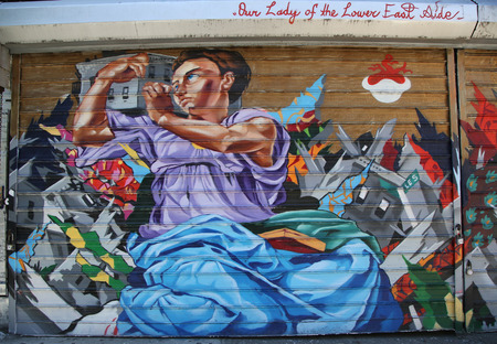 lower east side: NEW YORK - SEPTEMBER 20, 2015: Mural art at Lower East Side in Manhattan. A mural is any piece of artwork painted or applied directly on a wall, ceiling or other large permanent surface Editorial
