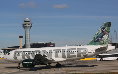 frontier: CHICAGO - OCTOBER 10, 2015: Frontier Airlines Airbus A319 aircraft taxing at O Hare International Airport in Chicago Editorial