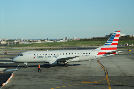 american airlines: NEW YORK- OCTOBER 10, 2015:  American Eagle Embraer ERJ-145 aircraft taxing at La Guardia airport in New York