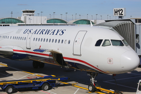 airways: CHICAGO - OCTOBER 10, 2015: US Airways plane at the gate at O Hare International Airport in Chicago Editorial