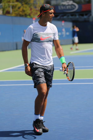 champion spain: NEW YORK - AUGUST 27, 2015: Fourteen times Grand Slam Champion Rafael Nadal of Spain practices for US Open 2015 at Billie Jean King National Tennis Center in New York
