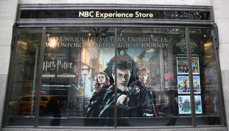 harry: NEW YORK - OCTOBER 8, 2015: NBC Experience Store window display decorated with Universal Orlando newest Harry potter theme rides in Rockefeller Center in Midtown Manhattan