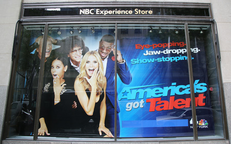 NEW YORK - OCTOBER 8, 2015: NBC Experience Store window display decorated with Americas got talent show logo in Rockefeller Center in Midtown Manhattan
