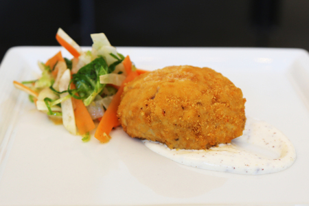 fresh food fish cake: Gourmet crab cake served with sauce and salad