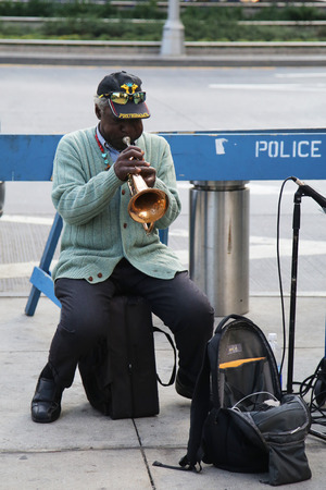 trumpet player: NEW YORK - OCTOBER 8, 2015: Trumpet player performing at Columbus Square in Manhattan