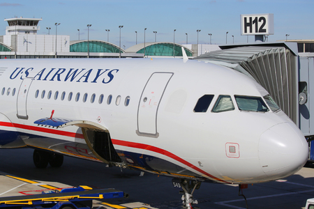 airways: CHICAGO - OCTOBER 10, 2015: US Airways plane at the gate at OHare International Airport in Chicago. US Airways completes final flight on October 18, 2015 Editorial