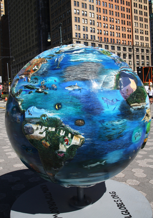 change of seasons: NEW YORK - SEPTEMBER 24, 2015: Cool globes exhibition at Battery Park in Lower Manhattan. It is a public art exhibition designed to raise awareness of solutions to climate change