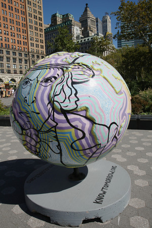 public project: NEW YORK - SEPTEMBER 24, 2015: Cool globes exhibition at Battery Park in Lower Manhattan. It is a public art exhibition designed to raise awareness of solutions to climate change